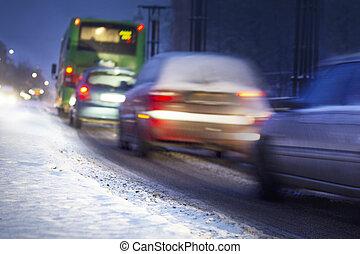 Winter traffic - Busy traffic in snowy winter evening