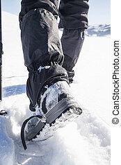 Winter trekking boots on snow path