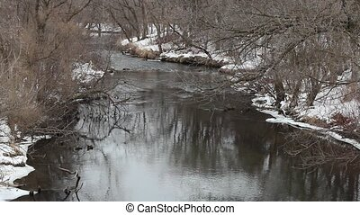 Winter trout stream - A small trout stream flows through the...