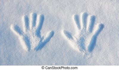 Winter - two handprints in the snow.