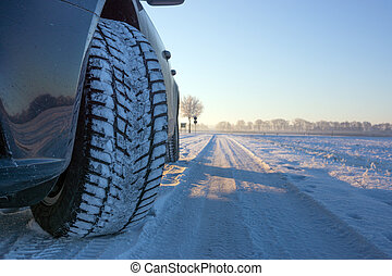 Winter tyre covered with snow