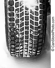 Winter tyre on a vehicle - Mud and snow tire tread packed ...