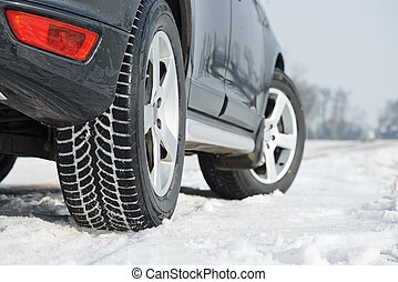 Winter tyres wheels installed on suv car outdoors