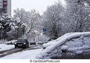 Winter urban scene. Snow on cars after snowfall.