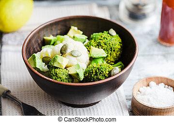 Winter vegetable salad with broccoli, cauliflower, avocados, pumpkin seeds