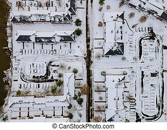 Winter view apartment complex from a height of one of the town residential