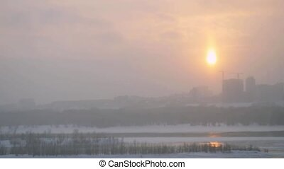 Winter view of Novosibirsk city during sunset and snowfall in slow motion.