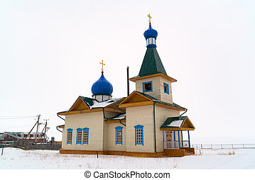 Winter view of St Nicholas Church on the shore of Lake Baikal in the village of Great Goloustnoye