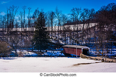 Winter view of White Rock Forge Covered Bridge in Lancaster...