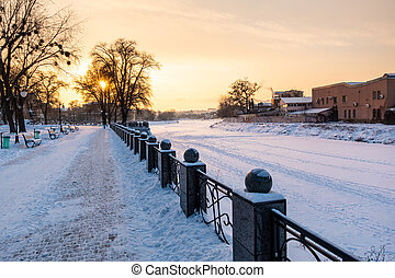 Winter view to empty snowy embankment of frozen Lopan river in Kharkov, Ukraine