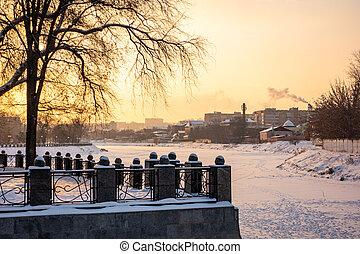 Winter view to snowy embankment of frozen Lopan river in Kharkov, Ukraine