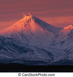 Winter volcanic landscape of Kamchatka Peninsula at violet sunset
