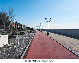 Winter walkway along the sea on a sunny day