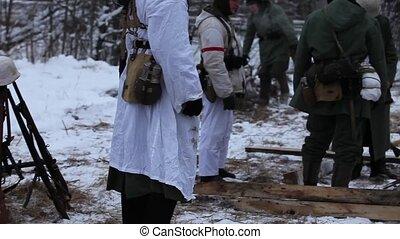 Winter war Soldiers around the ca - German soldier around...