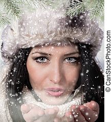 Winter woman Blowing Snow. Christmas Girl.