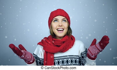 Winter woman holding hands palms up and catching copy space...