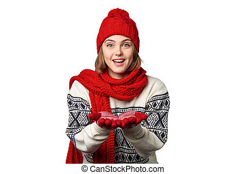 Winter woman holding opened palms in front of herself