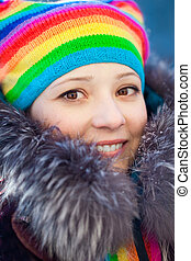 Winter woman in rainbow hat