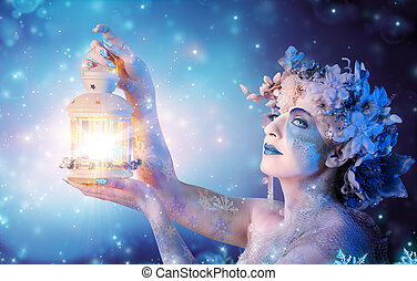 Winter woman portrait with lantern