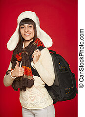 Winter woman tourist with backpack