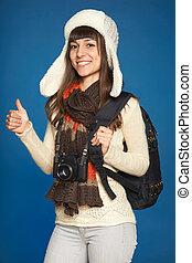 Winter woman traveler with photo camera
