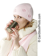 Winter woman with cup sideview