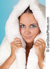 Winter woman with fur coat