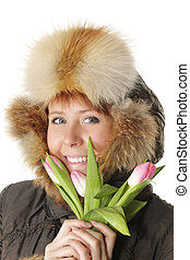 Winter woman with pink tulips