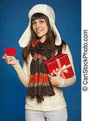 Winter woman with red gift box and credit card