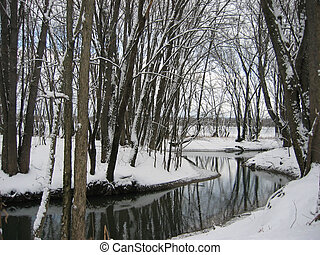 winter wonderland - a calm lays over a large stream that ...