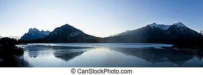 Frozen waters of the Vermillion Lakes with Sulphur Mountain in the distance near Banff, Alberta, Canada