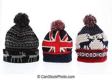 Winter woollen hats on white backgroung