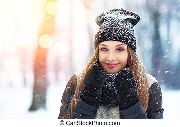 Winter young woman portrait. Beauty Joyful Model Girl...