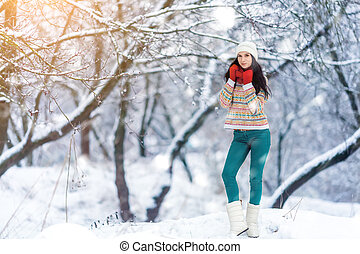 Winter young woman portrait. Beauty Joyful Model Girl laughing and having fun in winter park. Beautiful young woman outdoors. Enjoying nature, wintertime