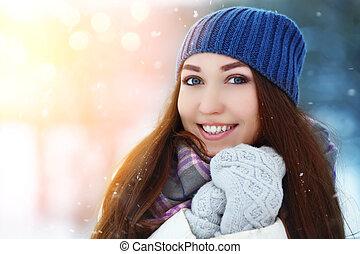 Winter young woman portrait. Beauty Joyful Model Girl laughing, having fun in winter park. Beautiful young woman laughing outdoors. Enjoying nature, wintertime