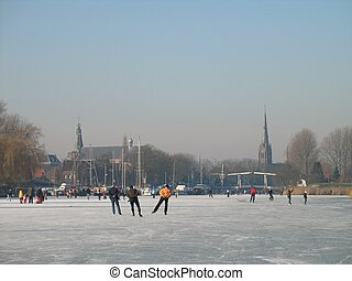 winter8011 - Holland, a crowd of skaters on the river near ...