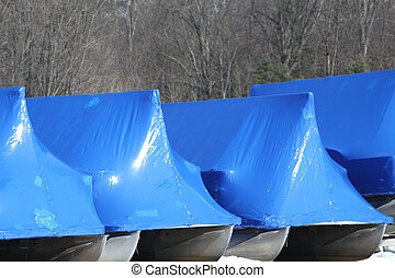 Winterized Boats - Boats shrink wrap to protect them from...