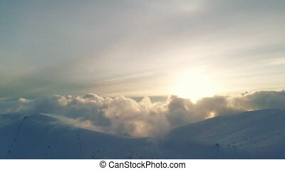 Winterland, fly over mountains in evening sunlight - Winter ...
