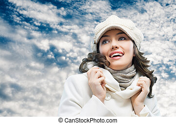 wintertime - a beauty girl on the sky background