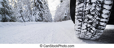 wintertyres on snow covered road