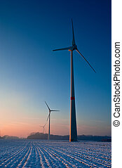 Wintery sunset on wind turbines