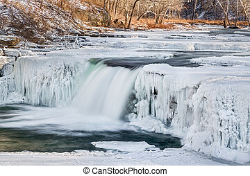 Indiana's Mill Creek flows through a wintry frozen landscape and over Lower Cataract Falls.