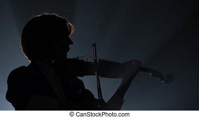 wiolinista, sylwetka, spełnianie, lantern., ciemny, tło., studio, czarnoskóry