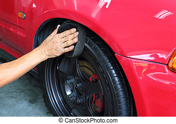 Wipe the wheel and tire red car
