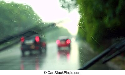 Wiper blades wipe the glass during rain - The wiper blades...