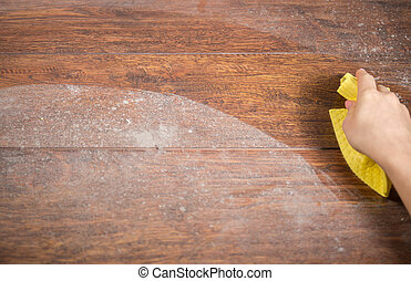 Wiping dusty wood using rag