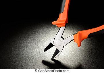 Wire cutter - Orange wire cutter on black matte surface