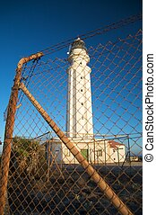 wire fence and lighthouse