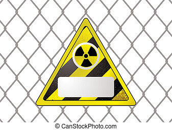 wire fence nuclear - triangular nuclear sign attached to a...