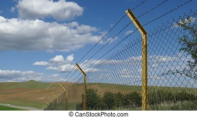 wire mesh fence deformed by immigrants at boundaries,